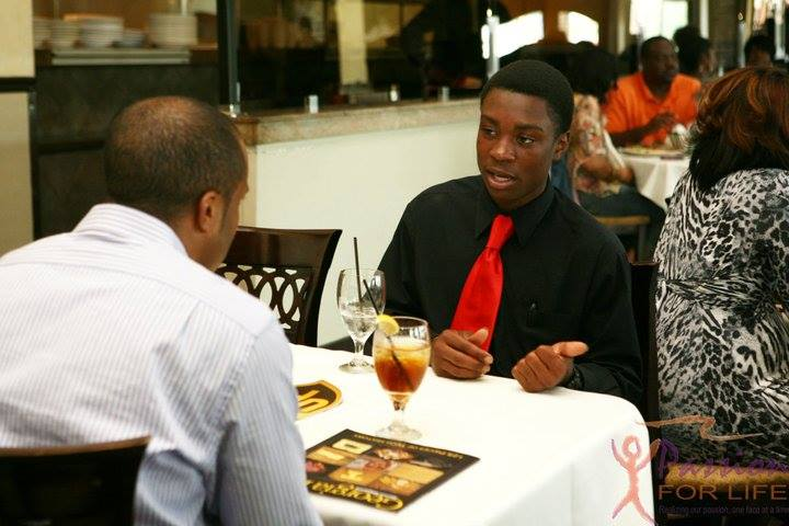 Student sitting at a table with mentor